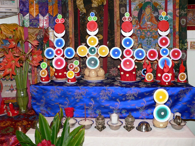 the main tormas with offering bowls in front